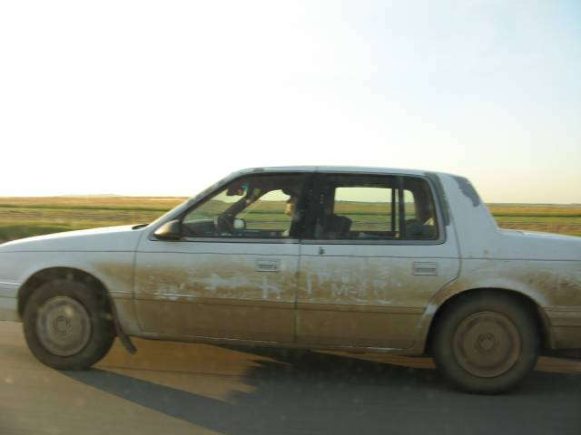 Dirty car on the road