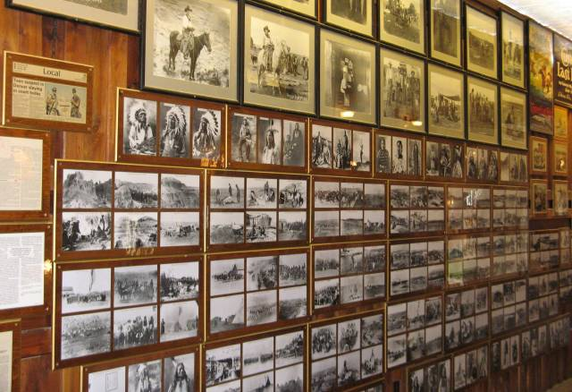 Old time photos on a wall at Wall Drug