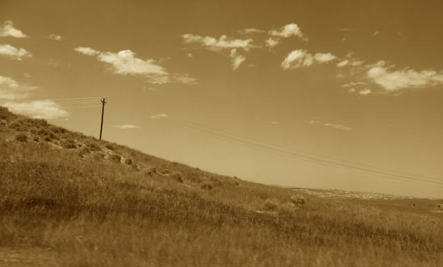 Telephone pole on a hill